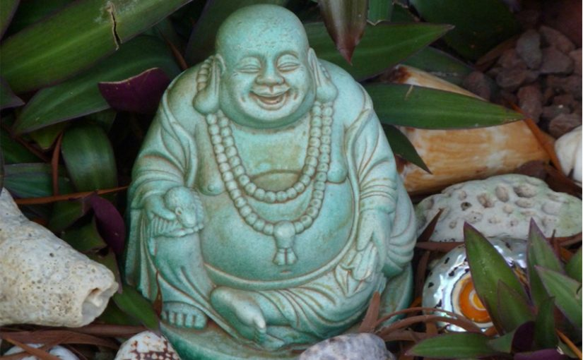 Green laughing Buddha sculpture photo by KRaschke