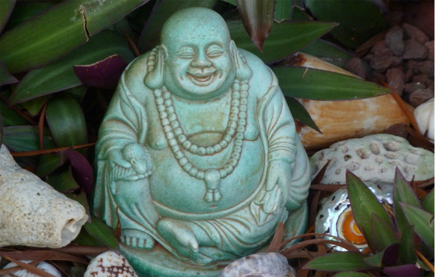 Green laughing Buddha sculpture photo by KRaschke